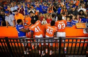 Florida Gators players sign autographs for the fans after spring game 2016-1280x855