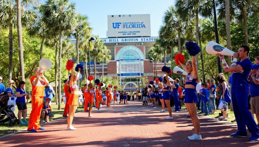University of Florida cheerleaders line the way before the Florida Gators football team enters Ben Hill Griffin Stadium before the 2016 Orange and Blue Debut- Florida Gators football- 1280x854