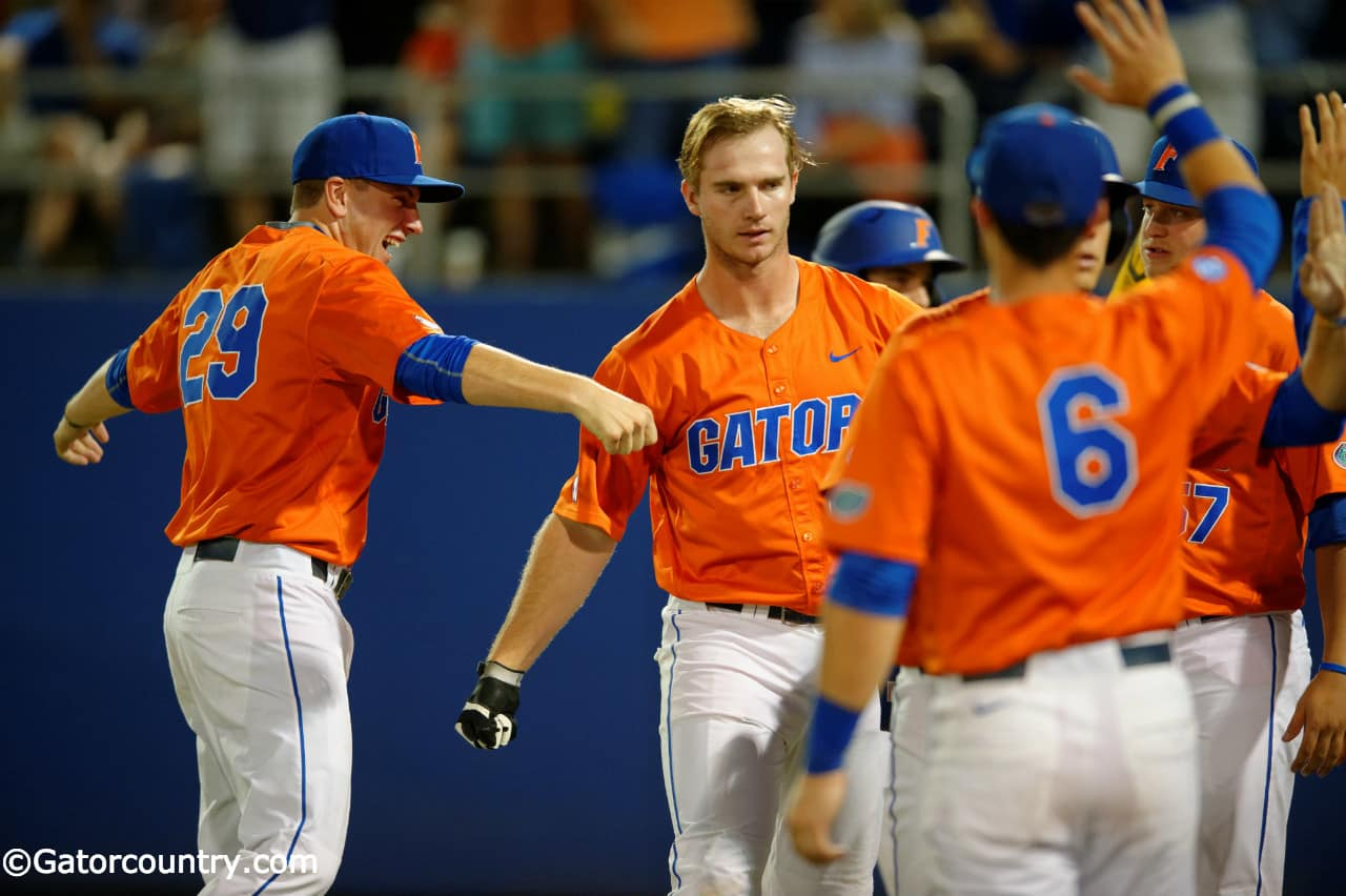 University of Florida junior first baseman Pete Alonso celebrates with teammates following his home run against Florida State- Florida Gators baseball- 1280x852
