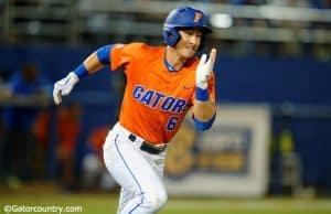 University of Florida third baseman Jonathan India runs to first base for a single against Florida State- Florida Gators baseball- 1280x852