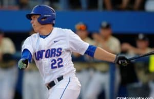 University of Florida catcher JJ Schwarz singles against the Vanderbilt Commodores at McKethan Stadium- Florida Gators baseball- 1280x852