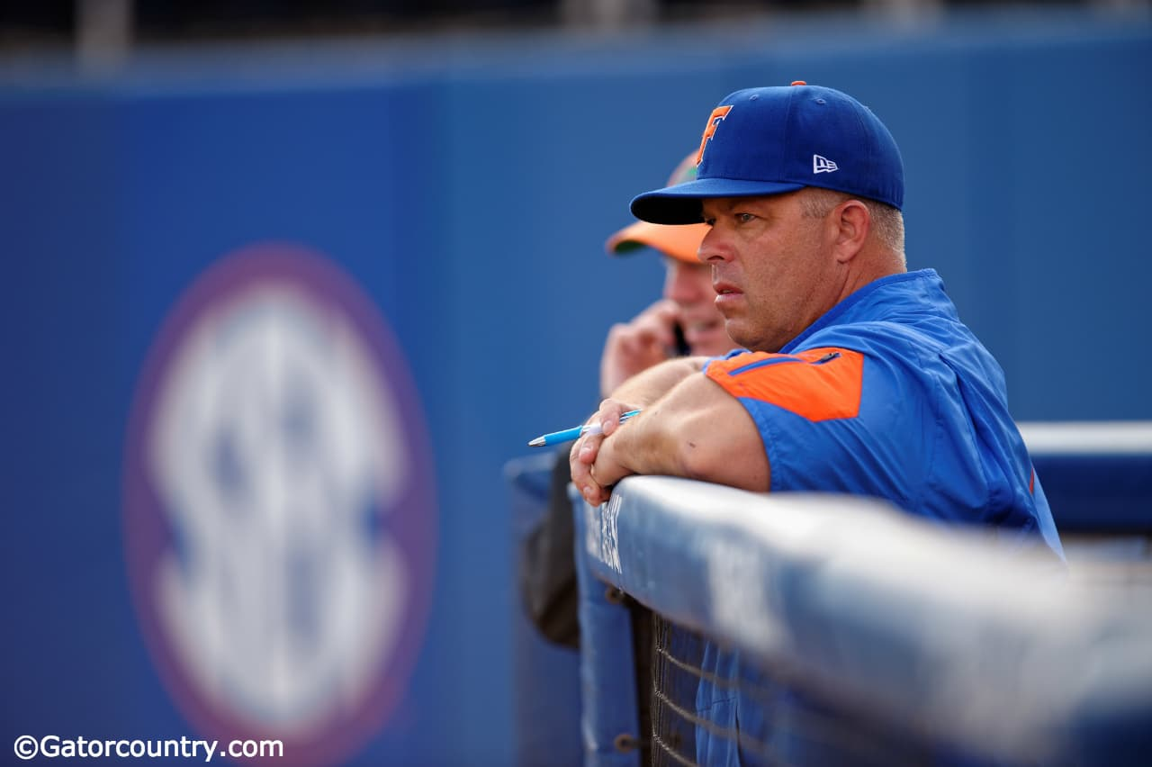 University of Florida head baseball coach Kevin O'Sullivan watches his team take pregame infield before a Friday night game against Vanderbilt- Florida Gators baseball- 1280x852