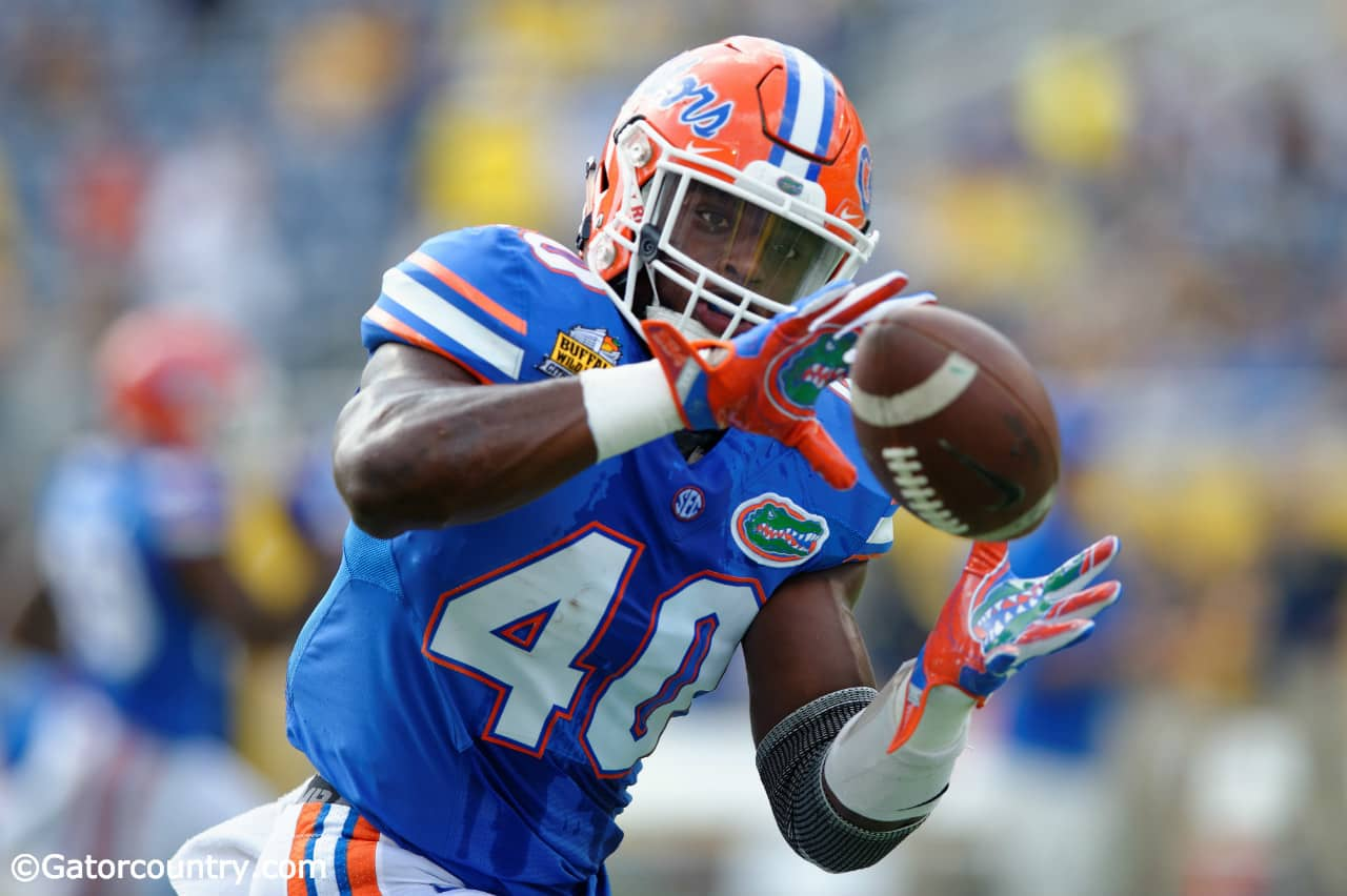 University of Florida linebacker Jarrad Davis catches a pass during warmups before the Buffalo Wild Wings Citrus Bowl vs. Michigan in 2016- Florida Gators football- 1280x852