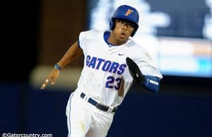 University of Florida outfielder Buddy Reed rounds third base before scoring the go-ahead run against Vanderbilt- Florida Gators baseball- 1280x852