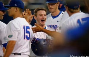 University of Florida second baseman Deacon Liput celebrates with teammates after scoring against Vanderbilt- Florida Gators baseball- 1280x852