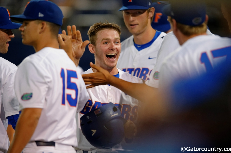 University of Florida second baseman Deacon Liput celebrates with teammates after scoring against Vanderbilt- Florida Gators baseball- 1280x852