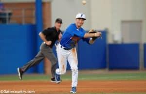 University of Florida third baseman Jonathan India fields and throws a ball to first against Florida Gulf Coast- Florida Gators baseball- 1280x852