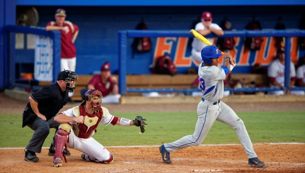 University of Florida outfielder Buddy Reed swings at a pitch during a 2015 Super Regional matchup against Florida State- Florida Gators baseball- 1280x852