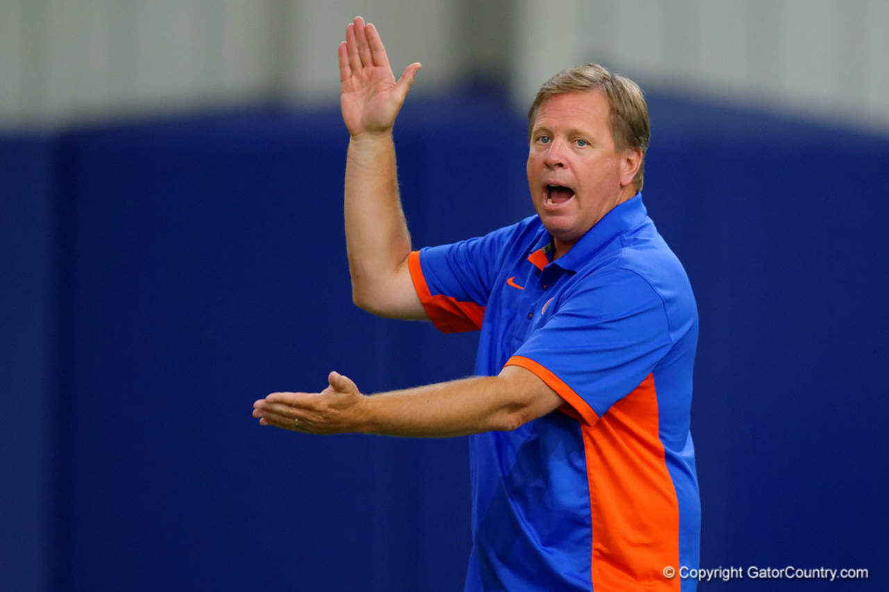Florida-gators-head-coach-jim-mcelwain-doing-the-chomp-during-friday-night-lights