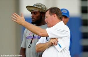 University of Florida head coach Jim McElwain and senior linebacker Jarrad Davis talk during McElwain's youth football camp- Florida Gators football- 1280x852