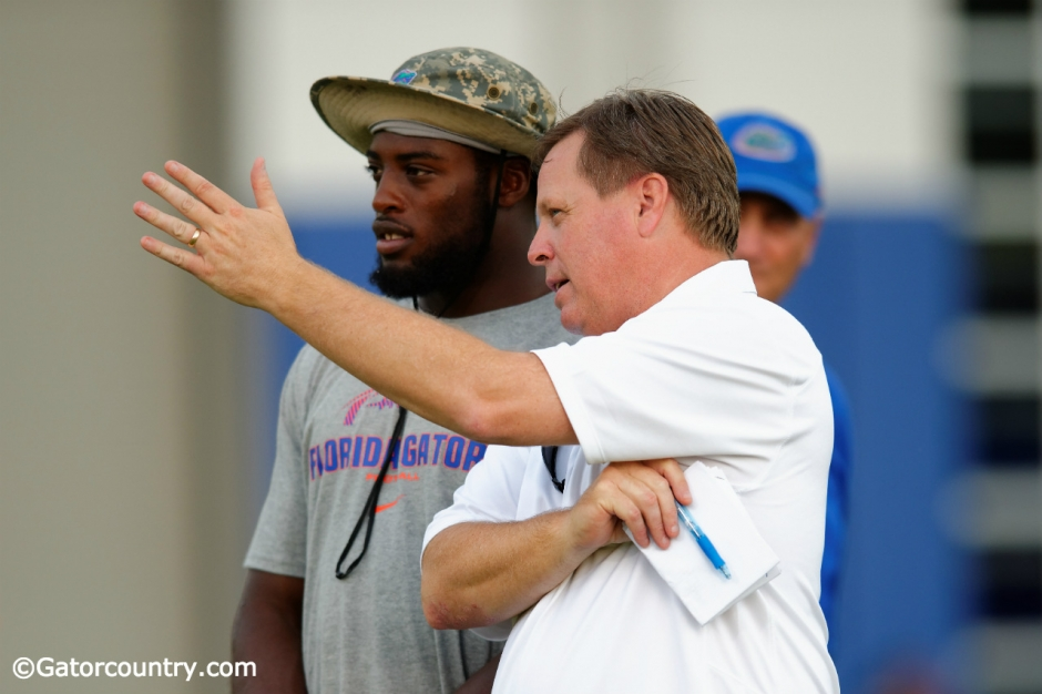 University of Florida head coach Jim McElwain and senior linebacker Jarrad Davis talk during McElwain's youth football camp- Florida Gators football- 1280x852