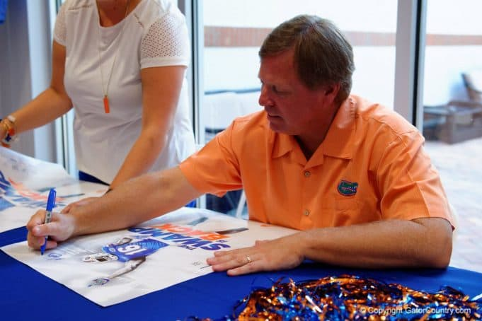Florida Gators head coach Jim McElwain signs autographs at fan day- 1280x853