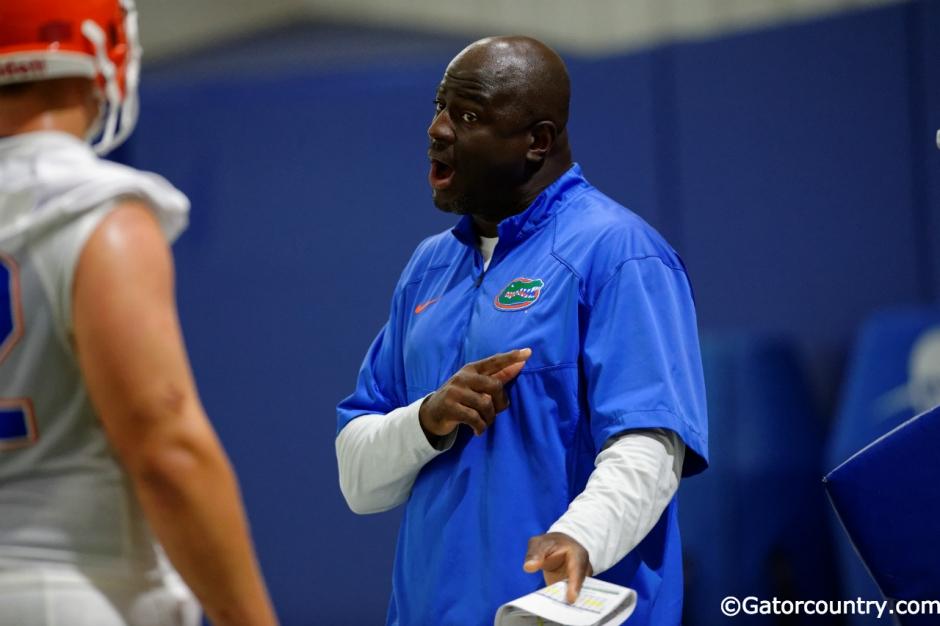 University of Florida defensive line coach Chris Rumph coaching during fall camp- Florida Gators football- 1280x852