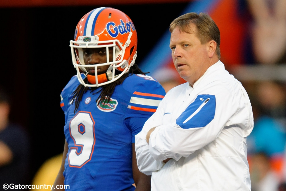 University of Florida head coach Jim McElwain and Dre Massey talk on the field during the Orange and Blue game- Florida Gators football- 1280x852