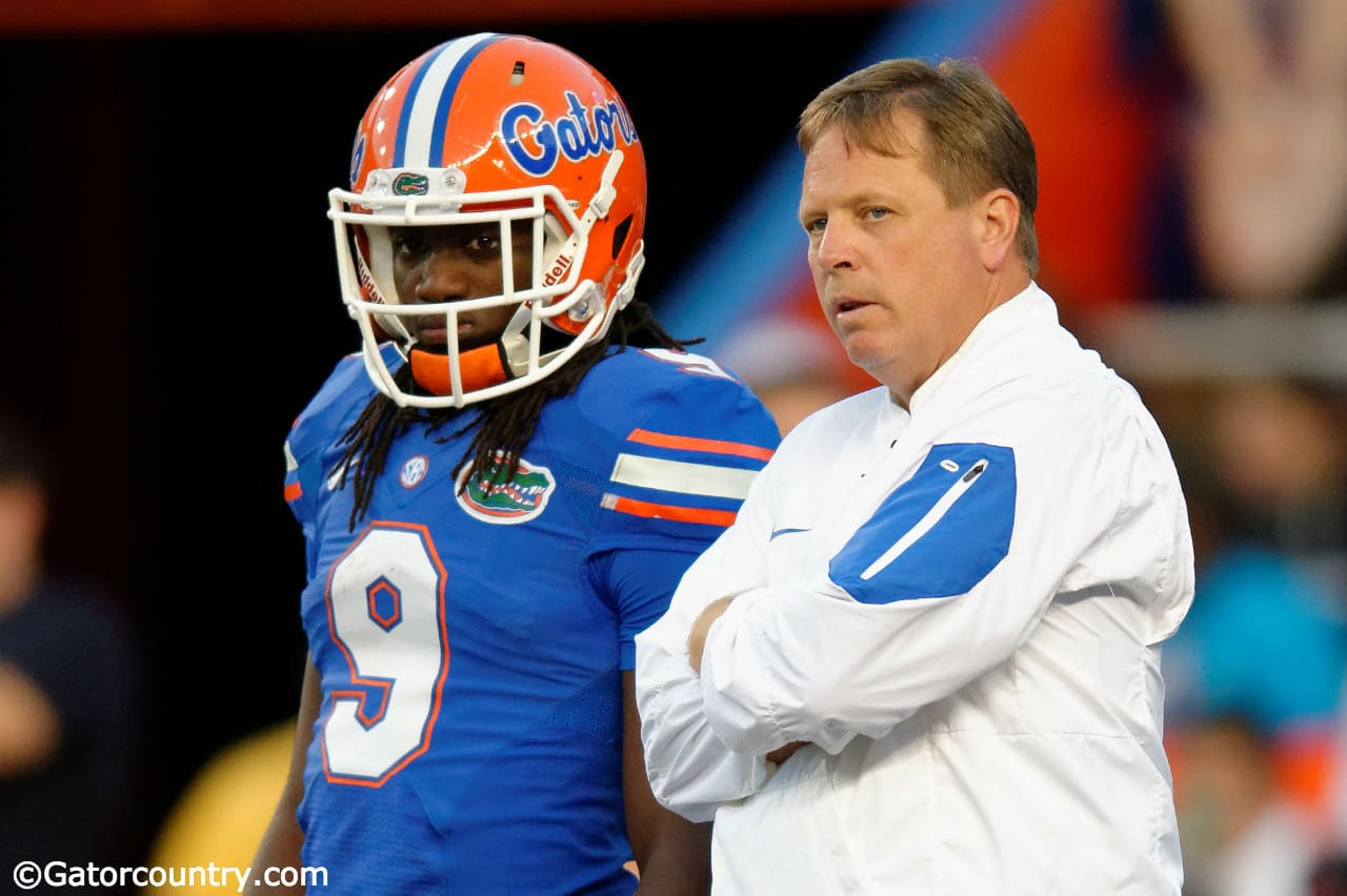 University-of-florida-head-coach-jim-mcelwain-and-dre-massey-talk-on-the-field-during-the-orange-and-blue-game-florida-gators-football-1280x852