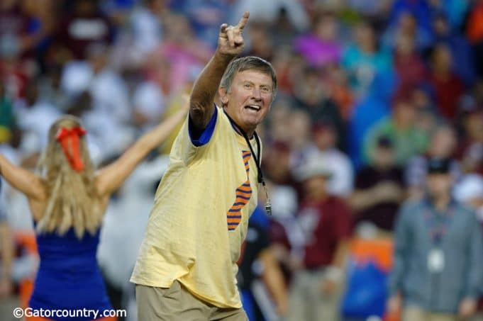 Former University of Florida head coach Steve Spurrier leads the crowd at Ben Hill Griffin Stadium in the Two Bits cheer- Florida Gators football- 1280x852