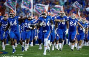 University of Florida senior defensive lineman Bryan Cox Jr. leads the team out onto the field before the home opener against UMass- Florida Gators football- 1280x852