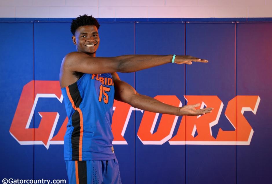 University of Florida big man John Egbunu chomps during basketball media day- Florida Gators basketball- 1280 x866