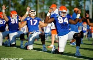University of Florida defensive lineman Bryan Cox Jr. goes through stretched before a practice during fall camp- Florida Gators football- 1280x852