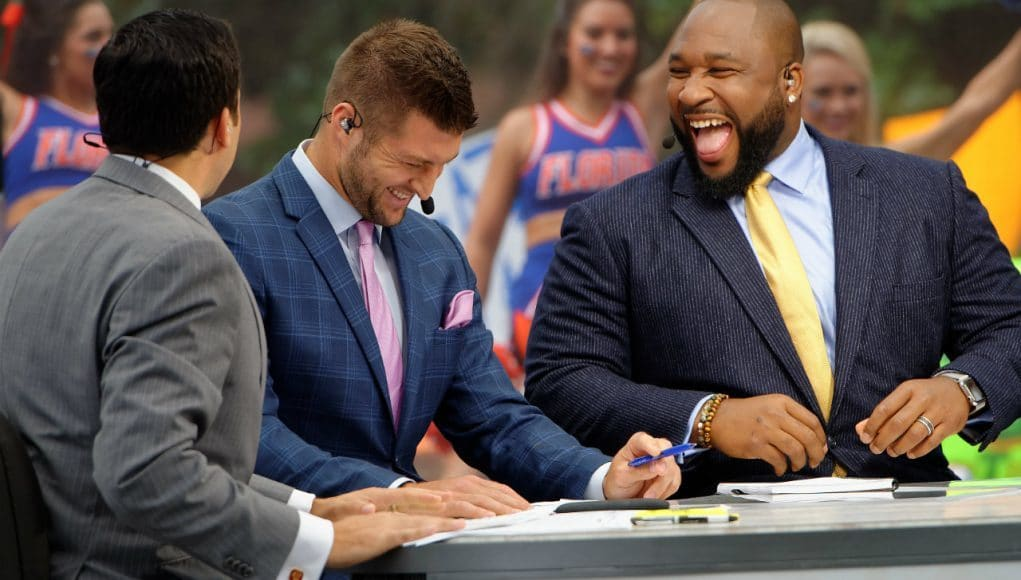 SEC Network analyst Marcus Spears and Tim Tebow laugh on set of SEC Nation during a broadcast in Gainesville- Florida Gators football- 1280x852