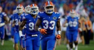University of Florida freshman linebacker David Reese runs out onto the field for his first collegiate game with the Florida Gators- Florida Gators football- 1280x852