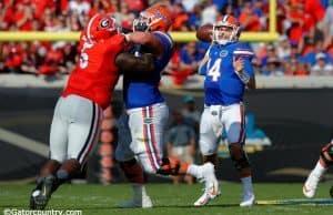 University of Florida quarterback Luke Del Rio throws a pass in a 24-10 win over the Georgia Bulldogs- Florida Gators football- 1280x852
