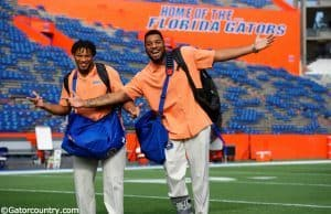 University of Florida senior Mark Herndon and sophomore CeCe Jefferson walk across Florida Field during Gator Walk - Florida Gators football- 1250x852