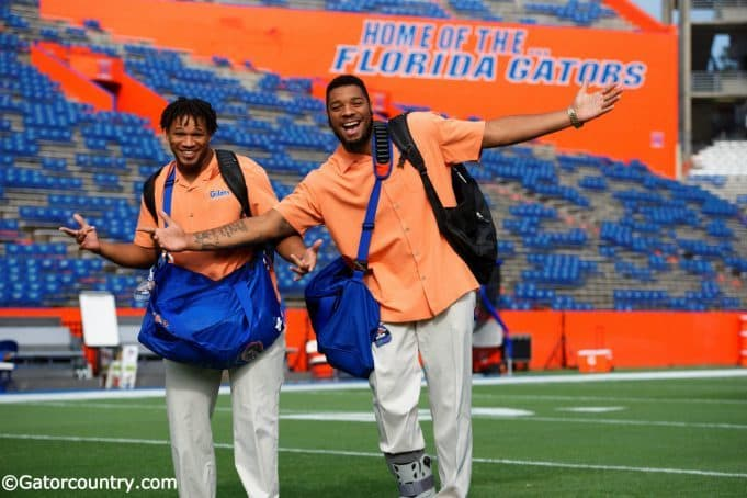 University of Florida senior Mark Herndon and sophomore CeCe Jefferson walk across Florida Field during Gator Walk - Florida Gators football- 1250x852
