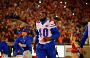University of Florida senior linebacker Jarrad Davis runs onto the field at Doak Campbell Stadium- Florida Gators football- 1280x852