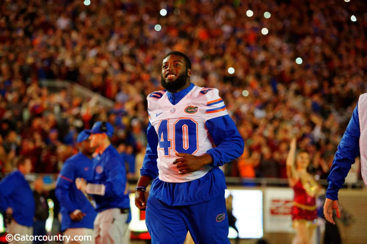 University-of-florida-senior-linebacker-jarrad-davis-runs-onto-the-field-at-doak-campbell-stadium-florida-gators-football-1280x852