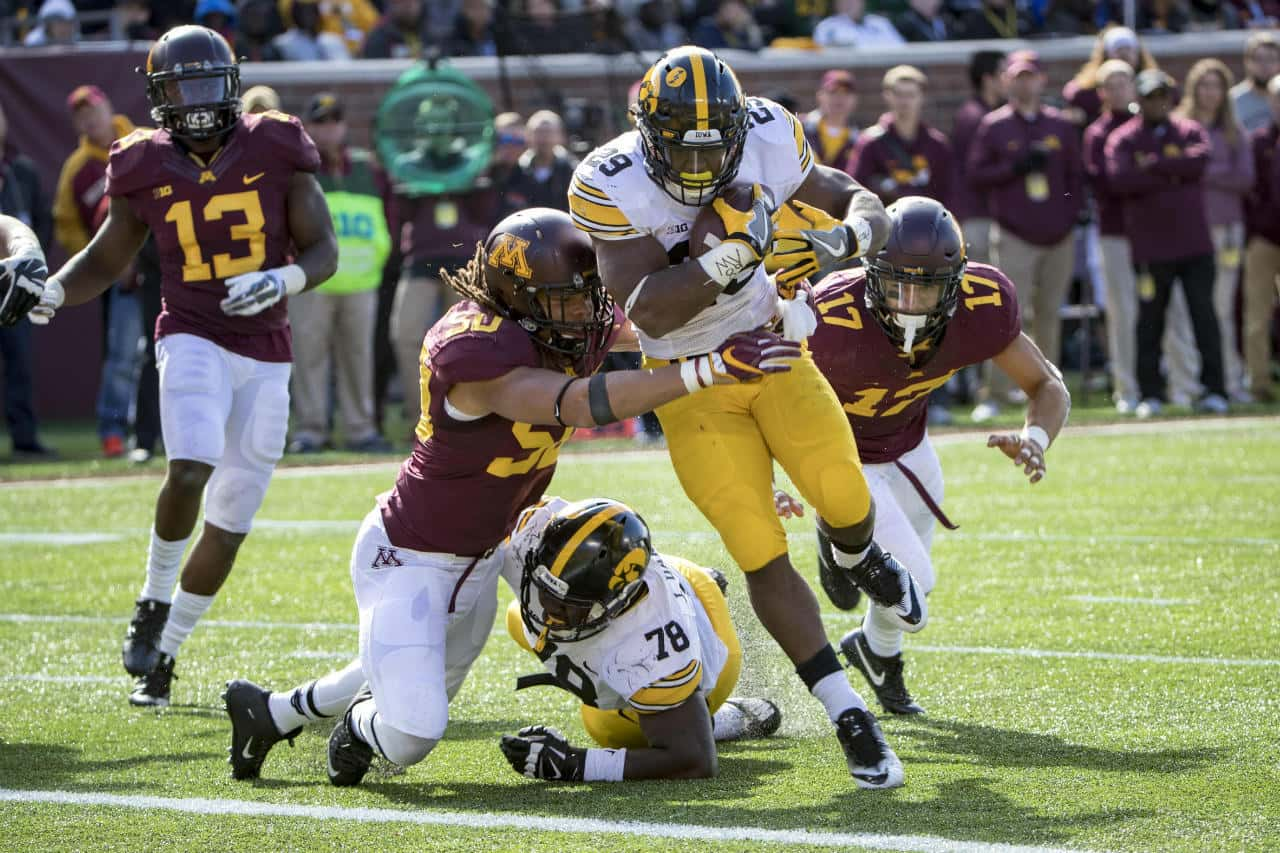 Oct 8, 2016; Minneapolis, MN, USA; Iowa Hawkeyes running back LeShun Daniels Jr. (29) rushes for a two point conversion as Minnesota Golden Gophers linebacker Jack Lynn (50) attempts to make a stop in the second half at TCF Bank Stadium. The Hawkeyes won 14-7. Mandatory Credit: Jesse Johnson-USA TODAY Sports