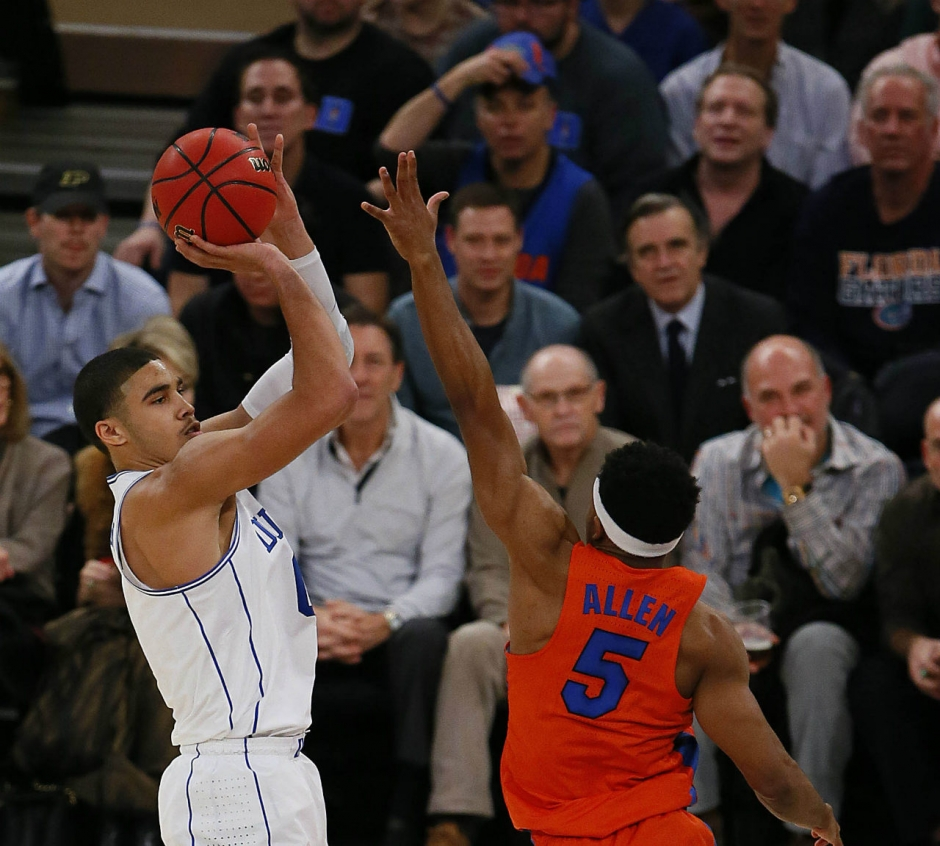 Dec 6, 2016; New York, NY, USA; Duke Blue Devils forward Jayson Tatum (0) shoots over Florida Gators guard KeVaughn Allen (5) during first half at Madison Square Garden. Mandatory Credit: Noah K. Murray-USA TODAY Sports