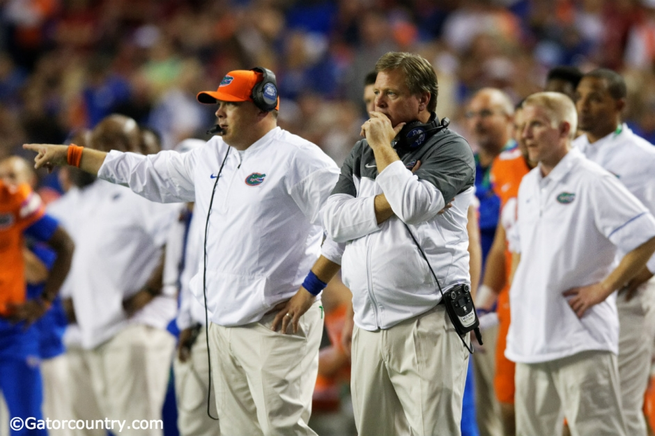 University of Florida head coach Jim McElwain and defensive coordinator Geoff Collins on the sideline during the SEC Championship- Florida Gators football- 1280x852