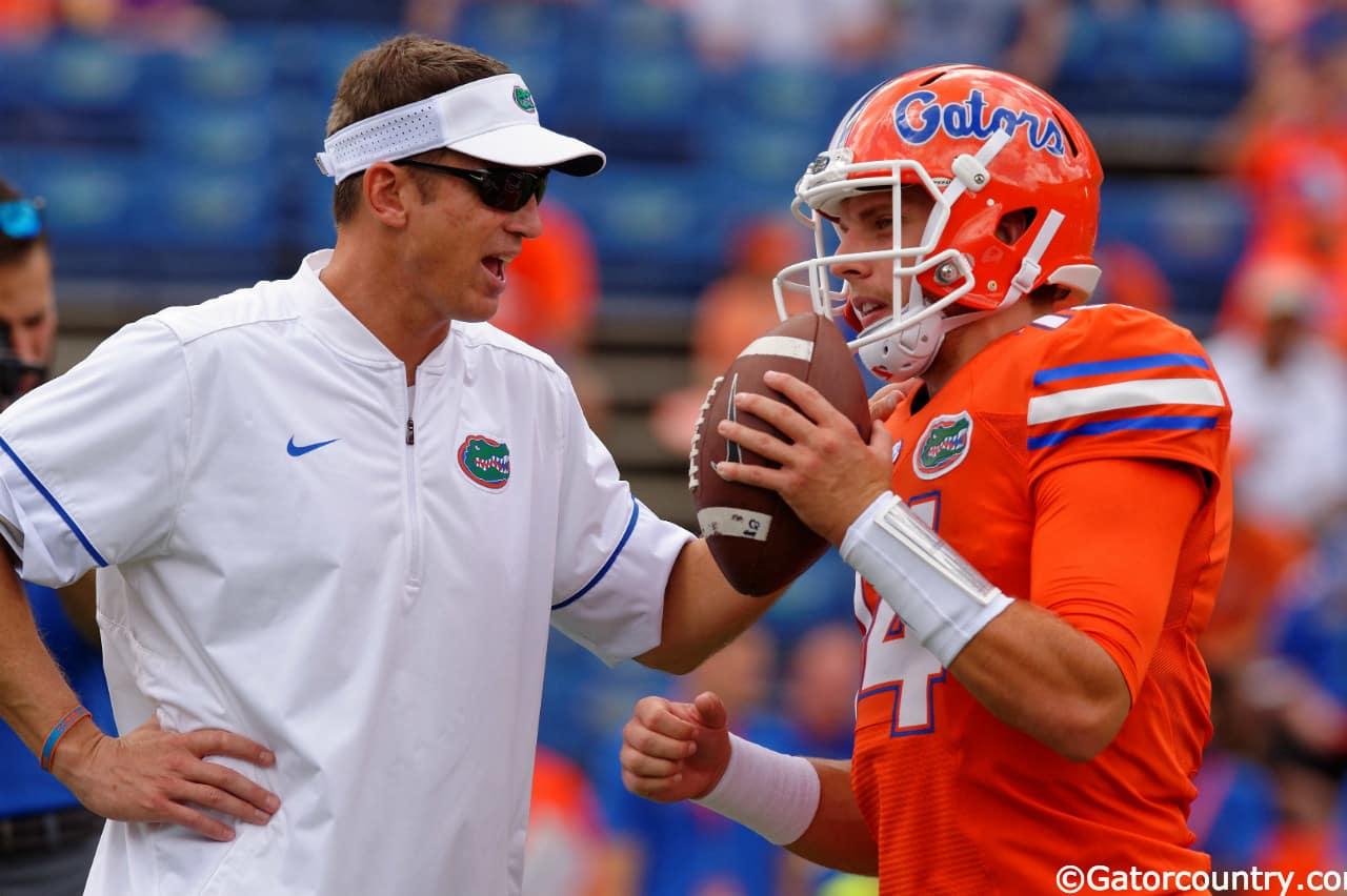 University of Florida offensive coordinator Doug Nussmeier talking with quarterback Luke Del Rio- Florida Gators football- 1280x852