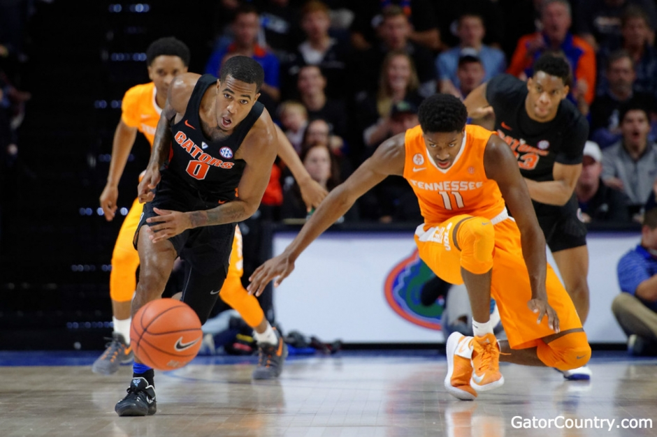 Florida Gators basketball guard Kasey Hill goes for the steal against Tennessee- 1280x853