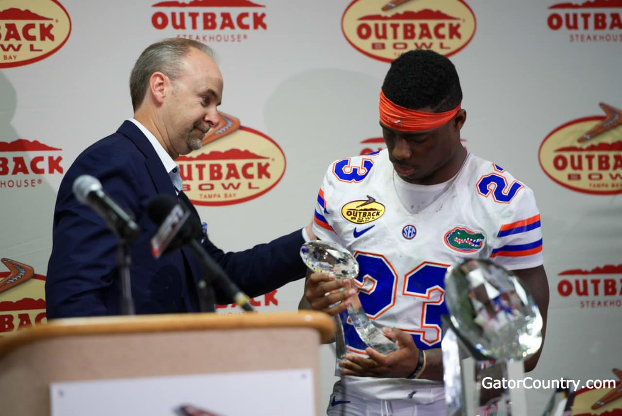 Florida Gators defensive back Chauncey Gardner with his Outback Bowl MVP trophy-1280x855