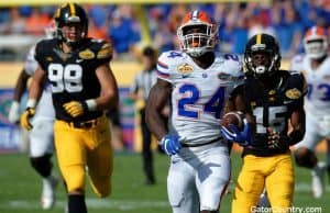 Florida Gators running back Mark Thompson scores against Iowa in the Outback Bowl- 1280x852