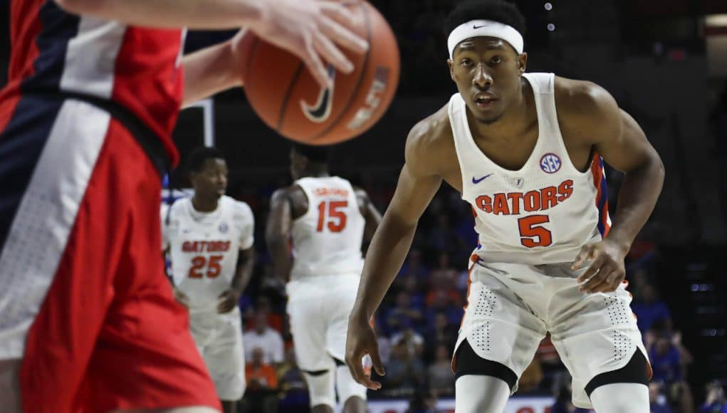 Jan 3, 2017; Gainesville, FL, USA; Florida Gators guard KeVaughn Allen (5) defends Mississippi Rebels guard Cullen Neal (2) in the first half at Exactech Arena at the Stephen C. O'Connell Center. Mandatory Credit: Logan Bowles-USA TODAY Sports