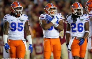 University of Florida defensive players Keivonnis Davis, David Reese and Marcell Harris on the field against Florida State- Florida Gators football- 1280x852