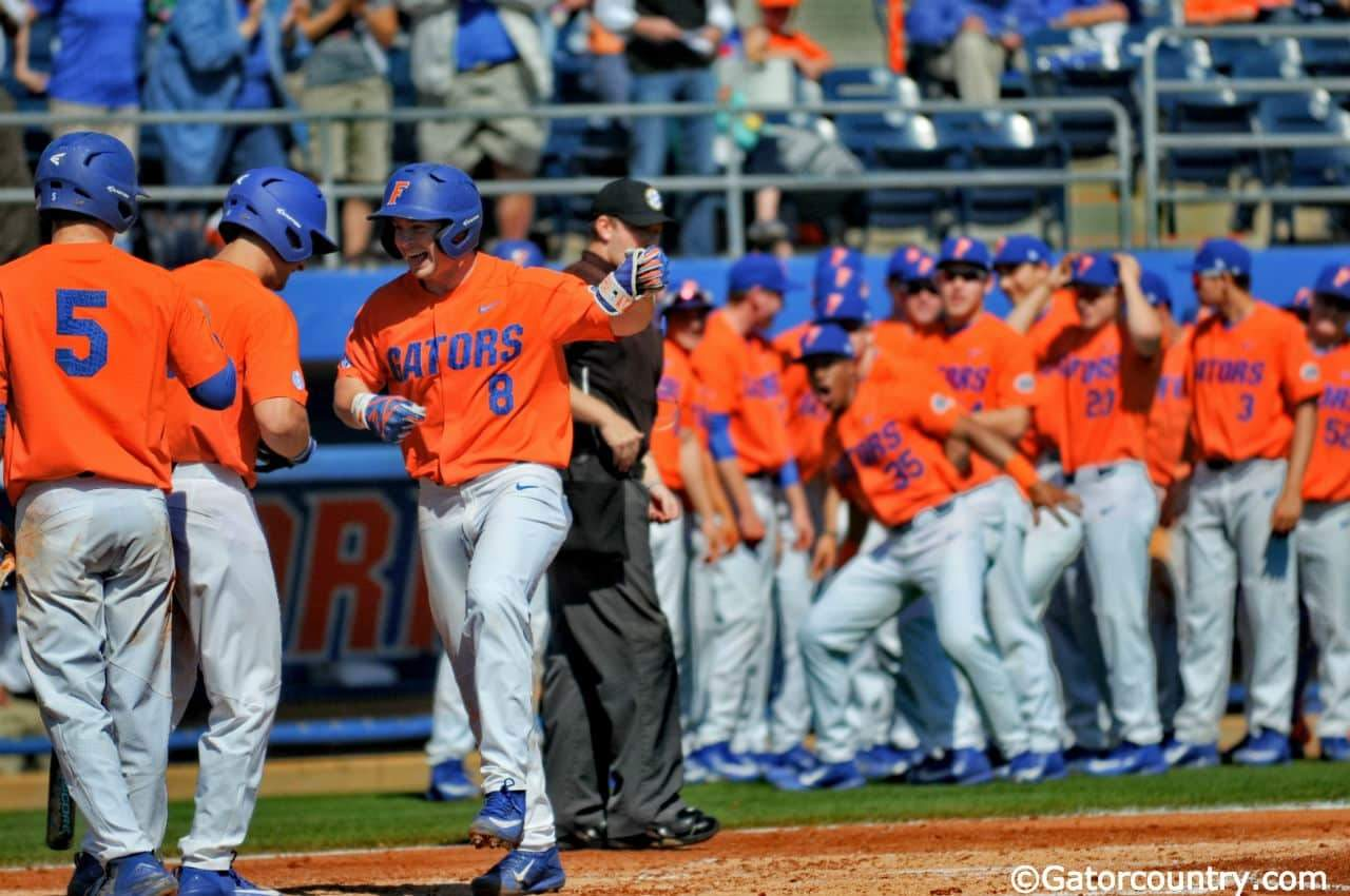 Florida Gators infielder Deacon Liput celebrates with his teammates after a home run against William & Mary- Florida Gators baseball- 1280x852