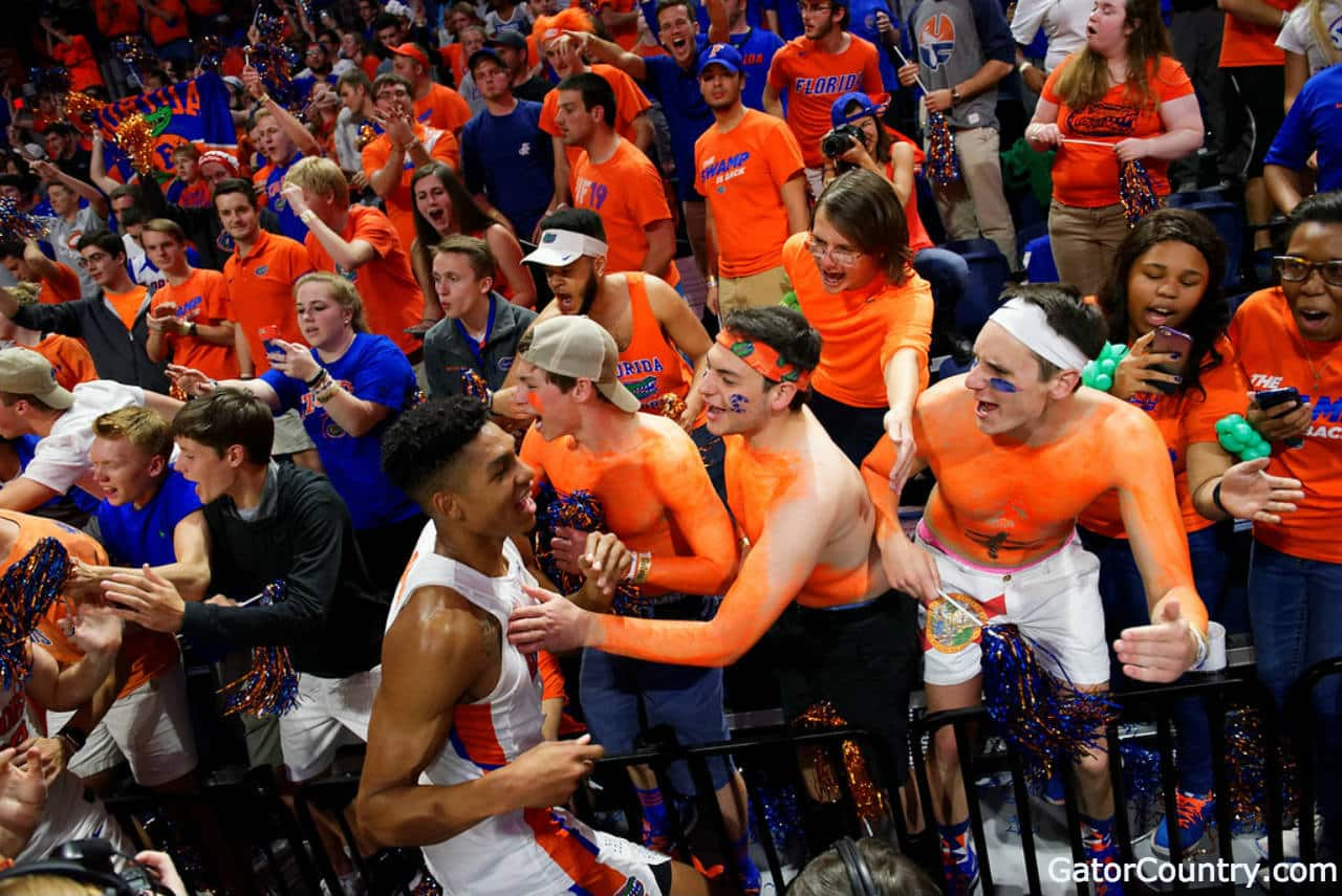 Florida Gators basketball player Devin Robinson celebrates with fans- 1280x855