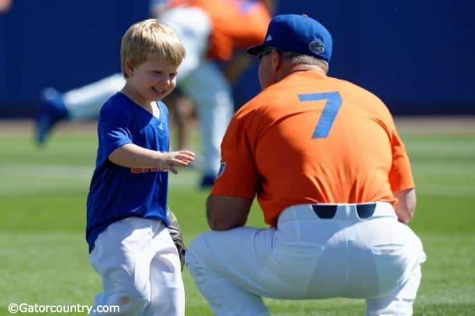 University of Florida head baseball coach Kevin O'Sullivan plays with his son Finn before the Gators final game against Miami- Florida Gators baseball- 1280x852