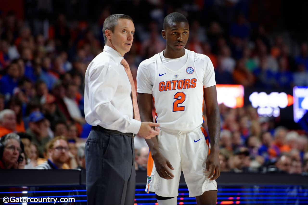 University of Florida men's basketball coach Mike White talks to guard Eric Hester during a blowout win over the Kentucky Wildcats- Florida Gators basketball- 1280x852