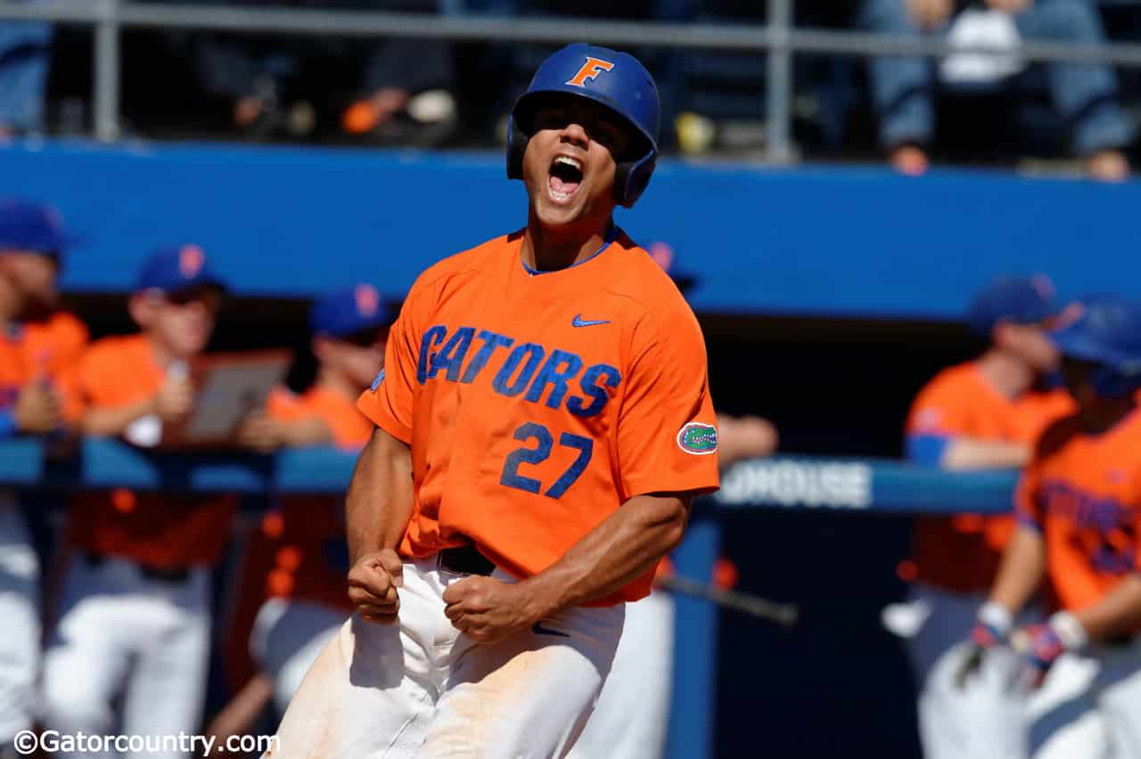 University of Florida outfielder Nelson Maldonado celebrates after scoring to give the Gators a 2-1 lead over Miami- Florida Gators baseball- 1280x852