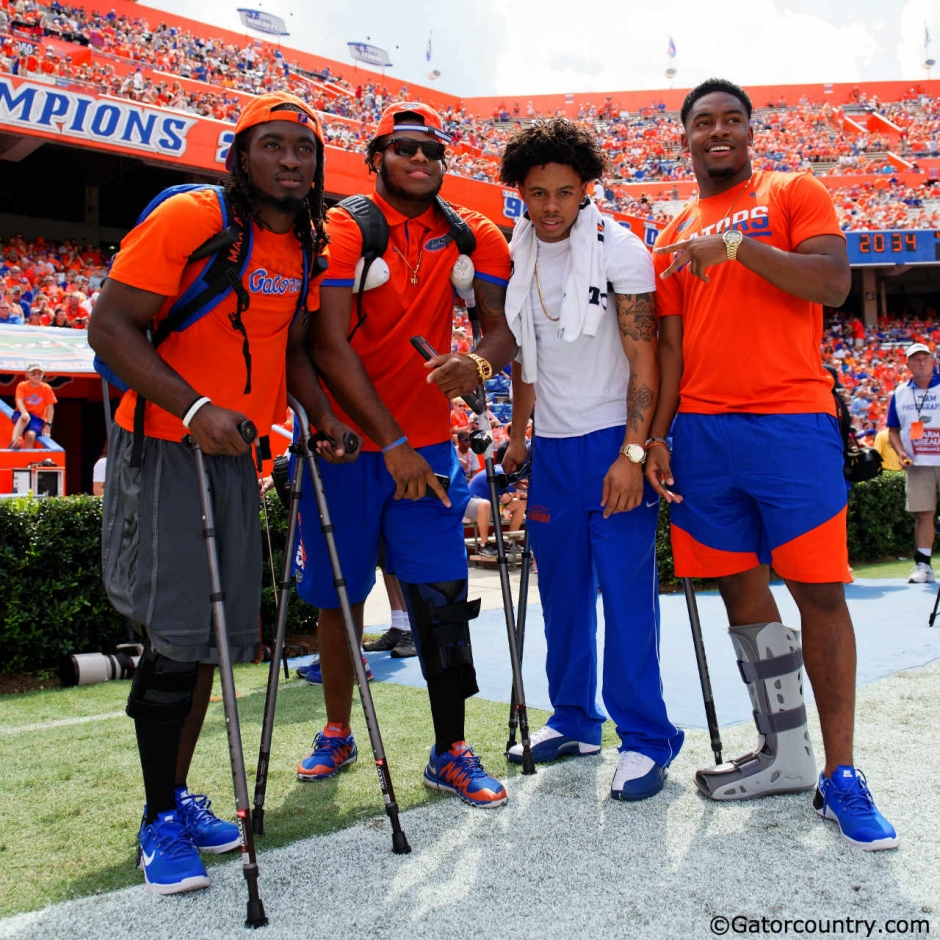 University of Florida players Dre Massey, Antonio Riles, C.J. McWilliams and Quincy Lenton watch the Gators play Kentucky- Florida Gators football- 1280x1280