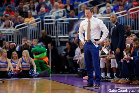 Florida Gators basketball coach Mike White looks on as the Gators play in the NCAA tournament- 1280x853