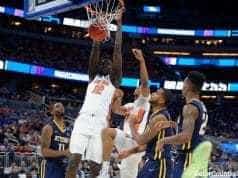 Florida Gators basketball player Gorjok Gak dunks against ETSU- 1280x853