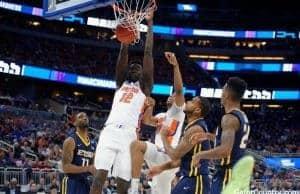 Florida Gators basketball player Gorjok Gak dunks against ETSU- 1280x853