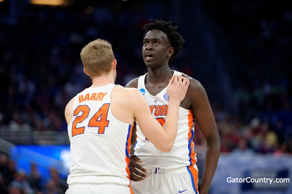 Florida Gators basketball players Gorjok Gak and Canyon Barry- 1280x853