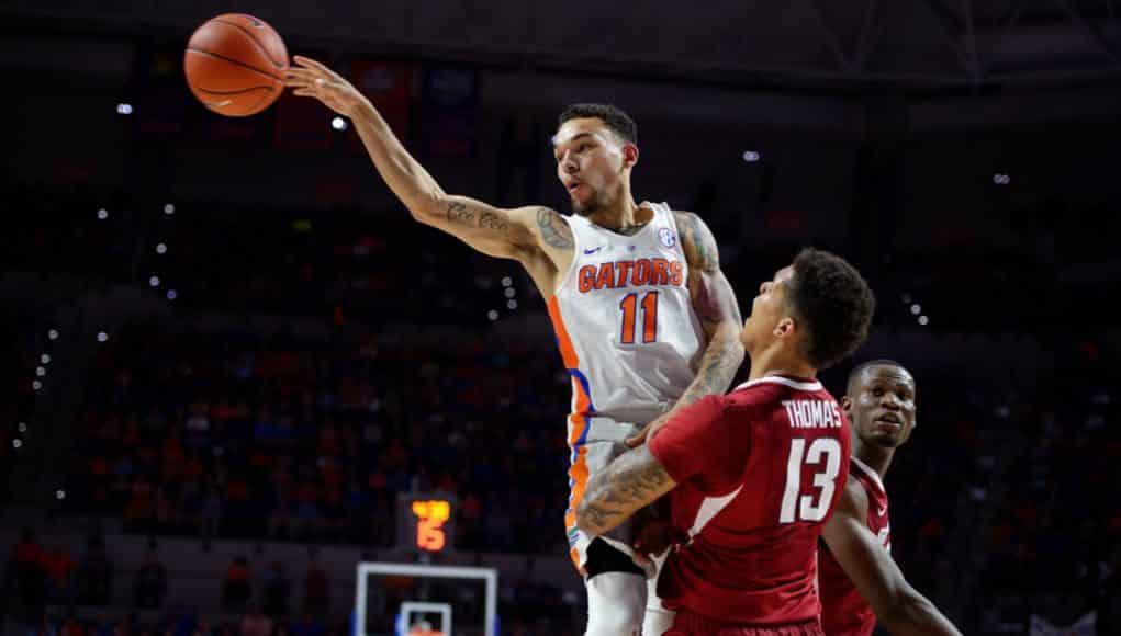 Florida Gators basketball point guard Chris Chiozza passes against Arkansas- 1280x853